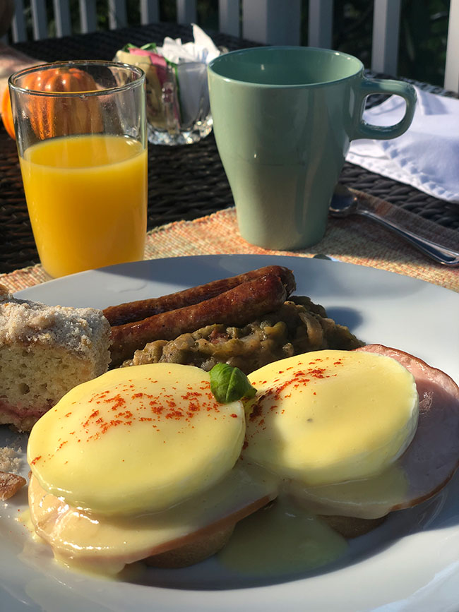 Breakfast with Eggs Benedict, Link Sausage, Country Mash Beans, Cherry Coffee Cake